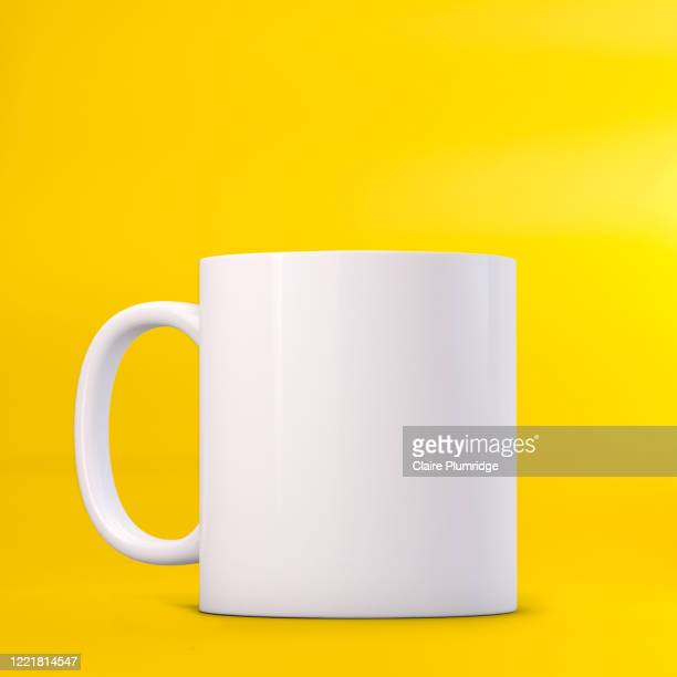 white mug mockup on a yellow background. perfect for businesses selling mugs, just overlay your quote or design on to the image. - newbury england stock pictures, royalty-free photos & images