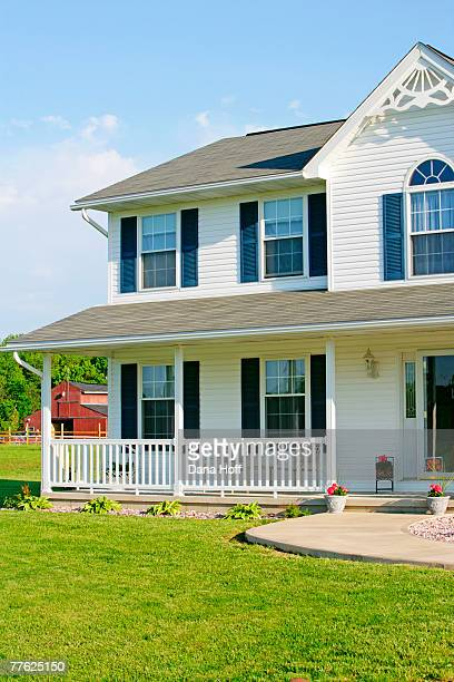 white multi-story house with barn in distance - dana white stock pictures, royalty-free photos & images