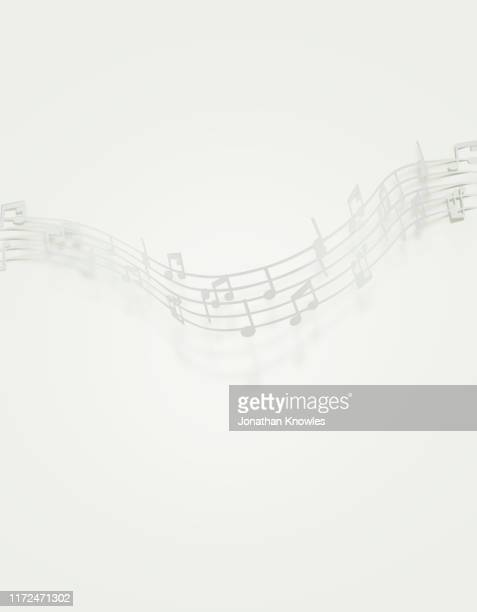 white music notes - note de musique photos et images de collection