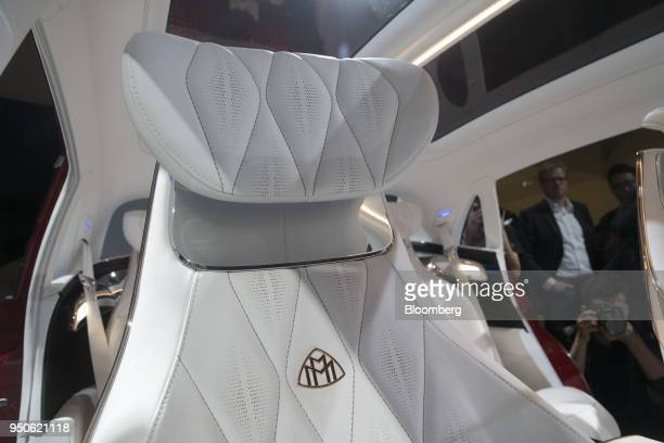 White nappaleather upholstered seating sits inside a Vision MercedesMaybach Ultimate Luxury concept vehicle manufactured by MercedesBenz a unit of...