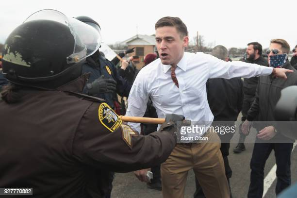 White nationalist Greg Conte argues with police after he and other altright advocates were attacked by counterdemonstrators before the start of a...