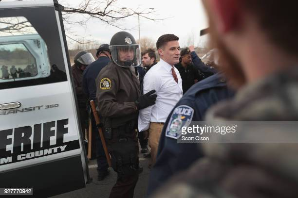 White nationalist Greg Conte is taken into custody after altright advocates clashed with counterdemonstrators before the start of a speech by white...