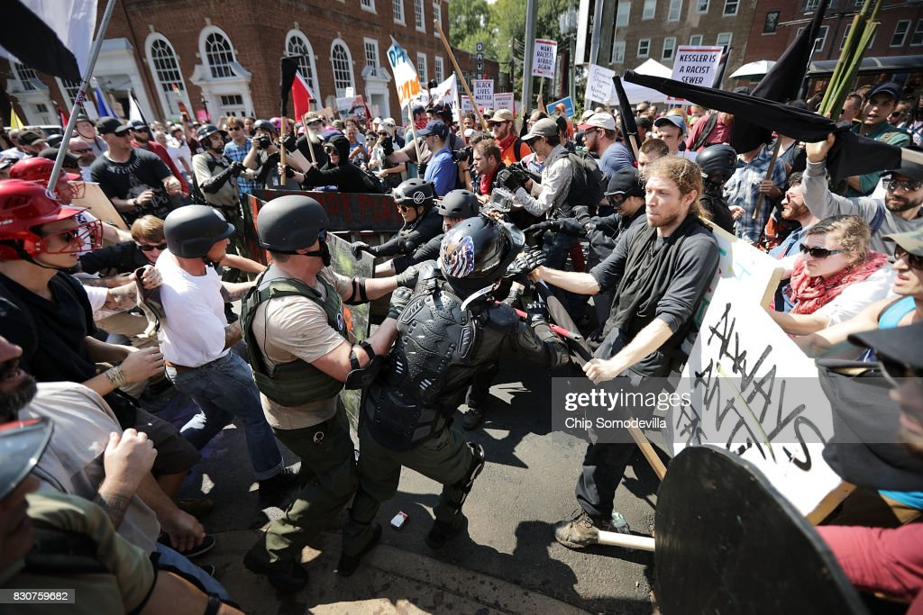 White nationalists, neo-Nazis and members of the 'alt-right' clash with counter-protesters as they enter Emancipation Park during the 'Unite the Right' rally August 12, 2017 in Charlottesville, Virginia. After clashes with anti-fascist protesters and police the rally was declared an unlawful gathering and people were forced out of Emancipation Park, where a statue of Confederate General Robert E. Lee is slated to be removed.