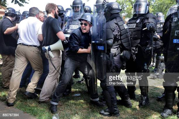 "White nationalists, neo-Nazis and members of the ""alt-right"" clash with police as they are forced out of Emancipation Park after the ""Unite the..."