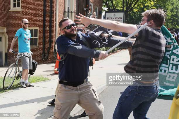 White nationalists neoNazis and members of the 'altright' clash with counterprotesters in the street after the 'Unite the Right' rally was delcared a...