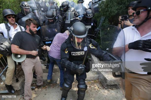 White nationalists neoNazis and members of the 'altright' clash with police as they are forced out of Emancipation Park after the 'Unite the Right'...