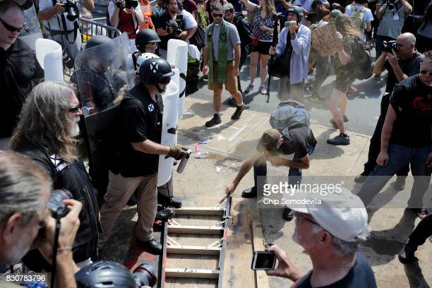 White nationalists neoNazis and members of the 'altright' clash with counterprotesters as they attempt to guard the entrance to Emancipation Park...