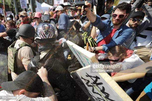 White nationalists neoNazis and members of the altright exchange vollys of pepper spray with counterprotesters as they enter Emancipation Park during...