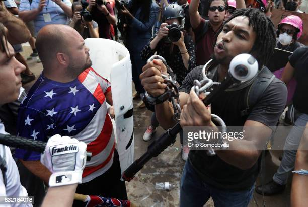 White nationalists neoNazis and members of the altright exchange insluts with counterprotesters as they attempt to guard the entrance to Emancipation...