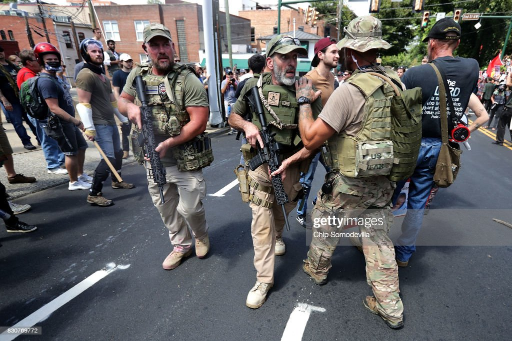 White nationalists, neo-Nazis and members of the 'alt-right' with body armor and combat weapons evacuate comrades who were pepper sprayed after the 'Unite the Right' rally was delcared a unlawful gathering by Virginia State Police August 12, 2017 in Charlottesville, Virginia. After clashes with anti-fascist protesters and police the rally was declared an unlawful gathering and people were forced out of Emancipation Park, where a statue of Confederate General Robert E. Lee is slated to be removed.