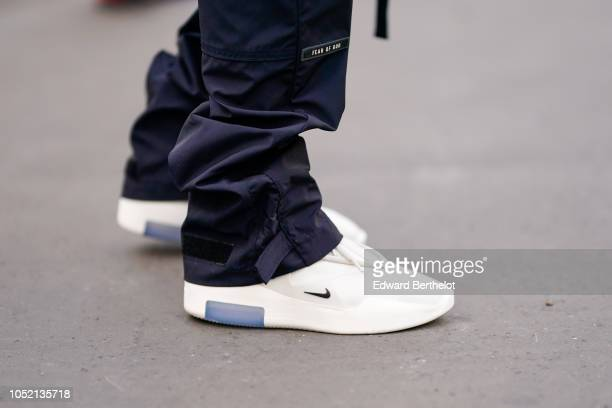 White Nike sneakers are seen outside Haider Ackermann during Paris Fashion Week Womenswear Spring/Summer 2019 on September 29 2018 in Paris France