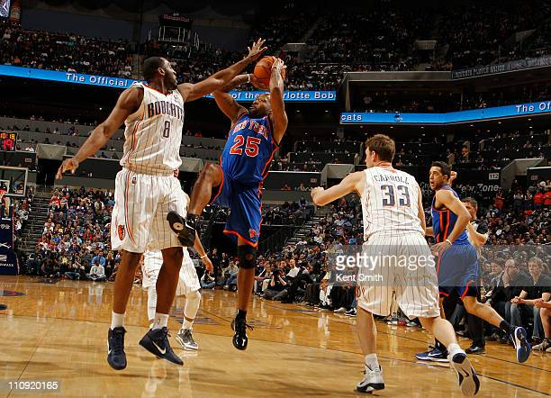 White of the Charlotte Bobcats defends the shot of Anthony Carter against the New York Knicks on March 26 2011 at Time Warner Cable Arena in...