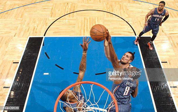 J White of the Charlotte Bobcats Tyrus Thomas of the Charlotte Bobcats and Ryan Anderson of the Orlando Magic battle for the ball control during the...