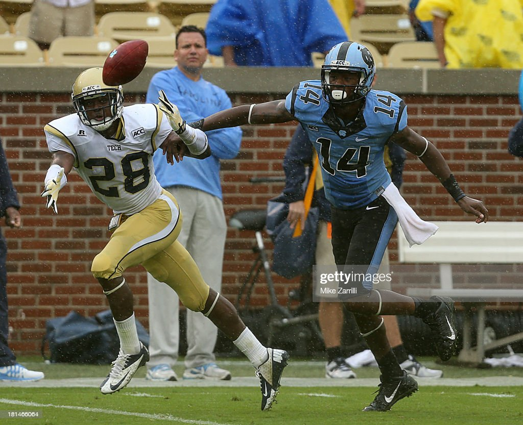 D.J. White #28 of the Georgia Tech Yellow Jackets and wide receiver Quinshad Davis #14 of the North Carolina Tar Heels chase an errant pass during the game at Historic Grant Field on September 21, 2013 in Atlanta, Georgia.