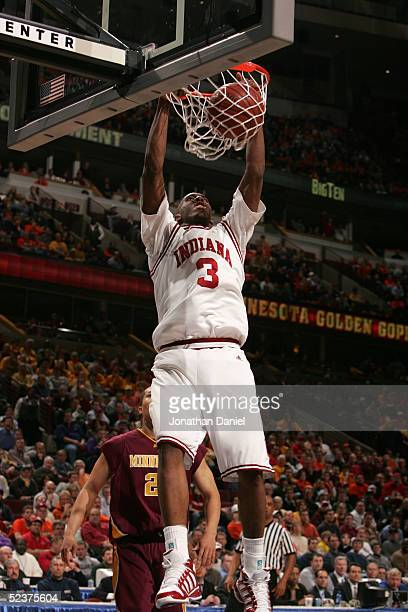 J White of the Indiana Hooisers dunks against the Minnesota Golden Gophers during the quaterfinals on the second day of the Big Ten Men's Conference...