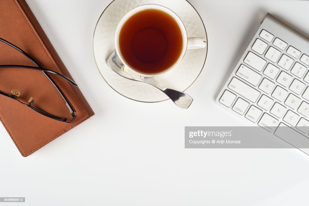 top office table cup. White Office Desk Table Top View With Computer Keyboard, Notepad, Cup Of Tea And E