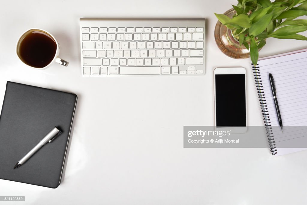 office table top. White Office Table Top View With Smart Phone, Computer Keyboard Copy Space : Stock Photo