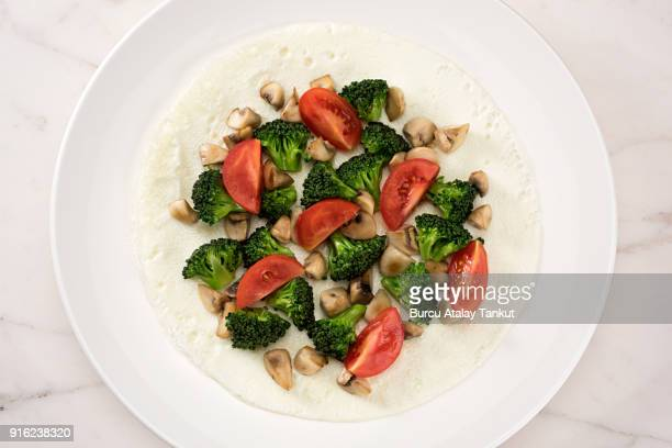 white omelet with broccoli, mushrooms and tomato - egg white stock pictures, royalty-free photos & images