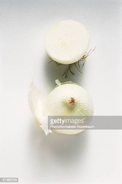 White onions, one cut in half, close-up