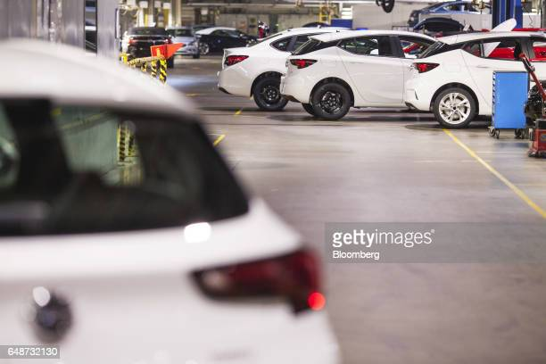 White Opel Astra vehicles sit at the end of the production line at the Opel automobile plant in Gliwice Poland on Monday March 6 2017 The maker of...