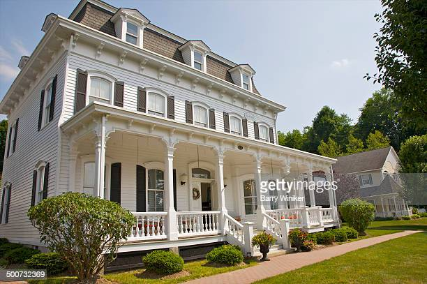 White ornate building facade with large porch