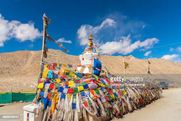 white pagoda on the highest road in the world khardung la pass, india. khardung la is a high mountain pass located in the ladakh region of the indian state of jammu and kashmir - monument stock pictures, royalty-free photos & images