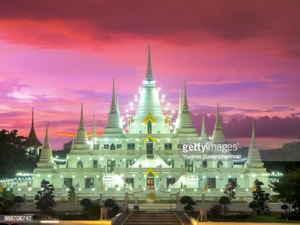 White Pagoda with Beautiful Twilight Sunset at Wat Asokaram Temple.