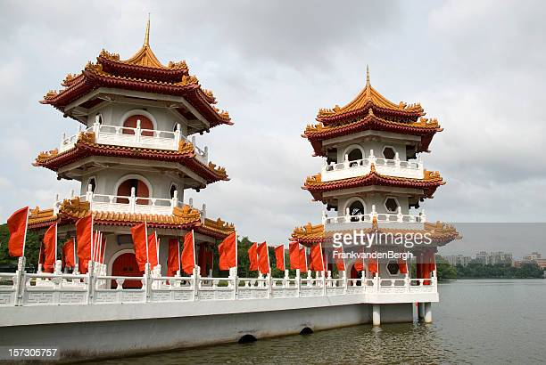 white pagoda with red flags - pagoda stock pictures, royalty-free photos & images