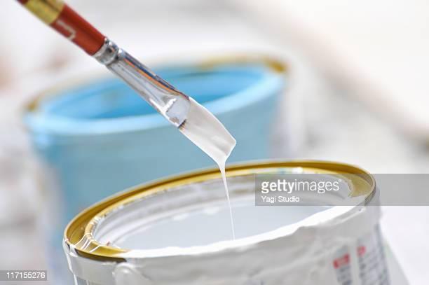 white paint and brush - farbeimer stock-fotos und bilder