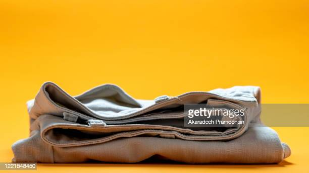 white pants placed on an orange background - trousers stock pictures, royalty-free photos & images