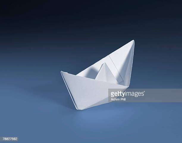 White paper boat in blue gradient back