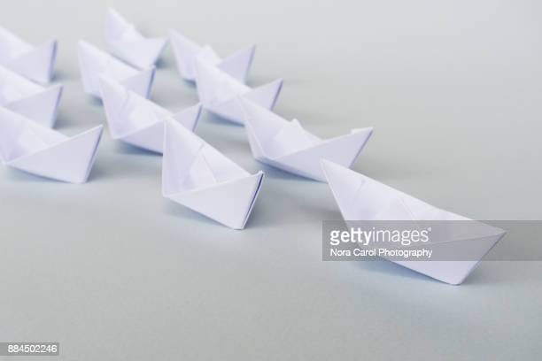 white paper boat leadership concept - following stock pictures, royalty-free photos & images