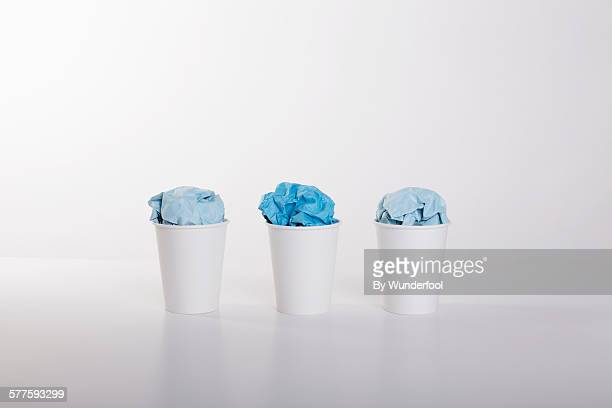 3 white paper cups with ice cream made of paper