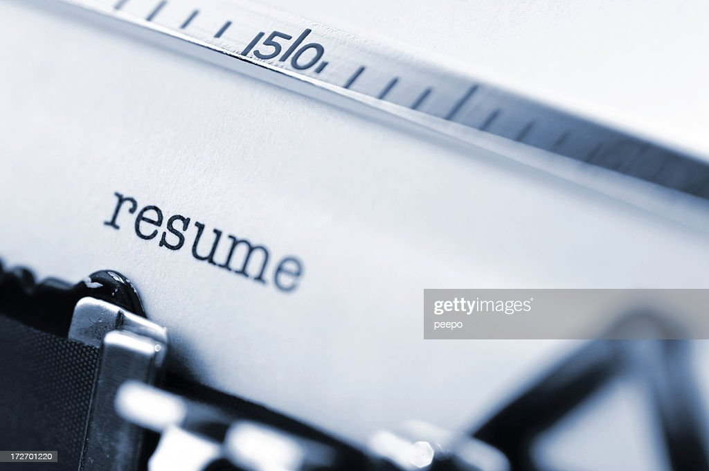 White paper in a typewriter with the word resume typed. : Stock Photo