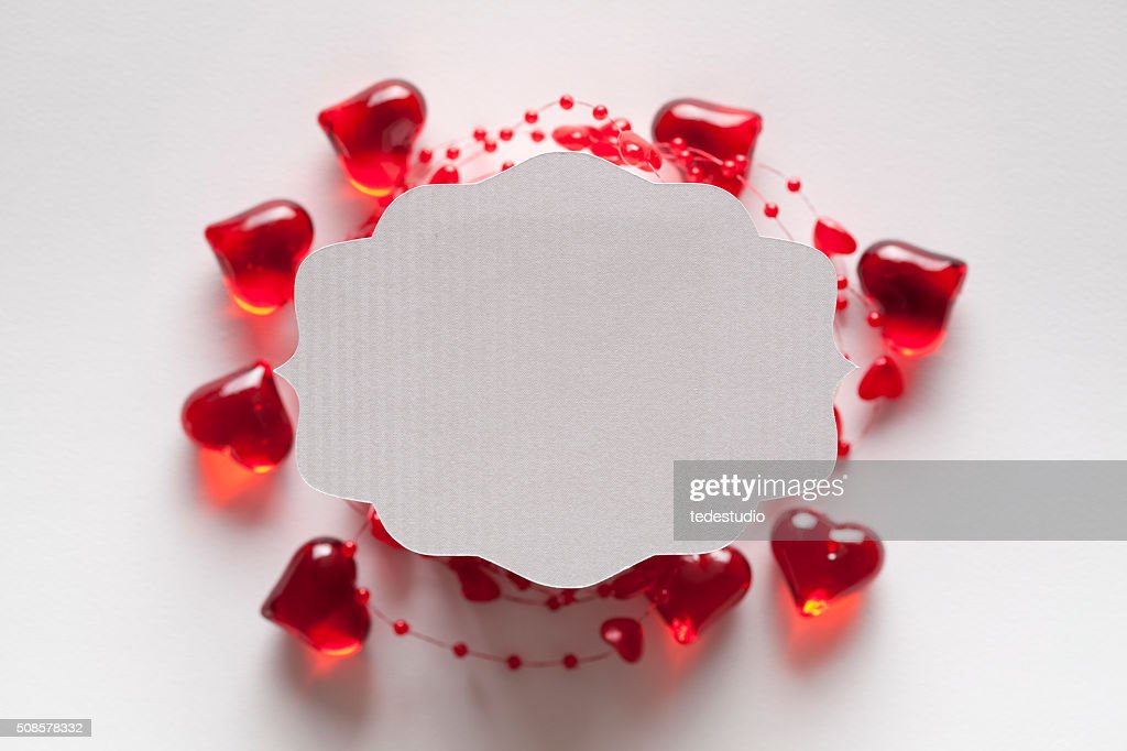 White paper label on red and white background : Stock Photo