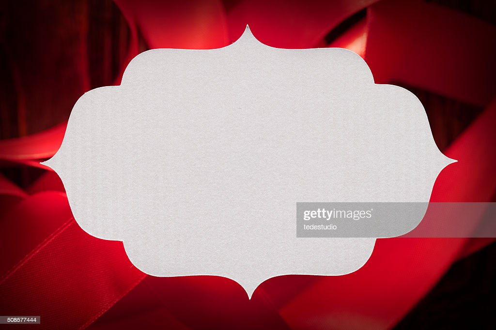 White paper label on red background : Stockfoto