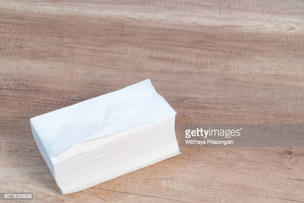 white paper napkin on wooden table, top view - paper napkin stock photos and pictures