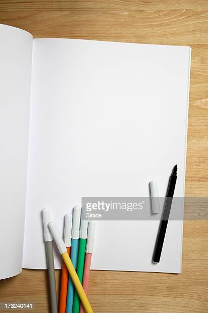 white paper notebook with color pens - colouring book stock photos and pictures