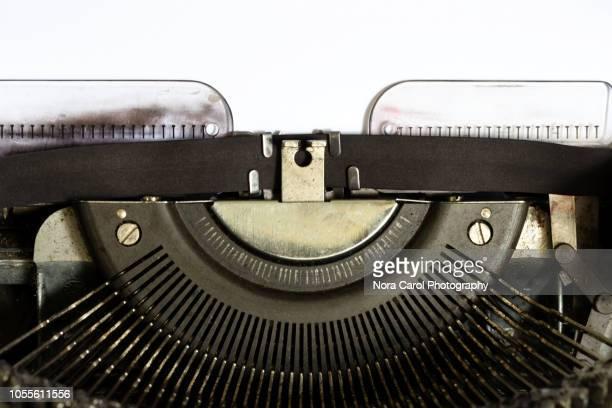 white paper on vintage typewriter - typewriter stock pictures, royalty-free photos & images