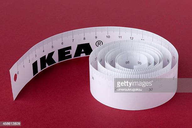 white paper tape measure - centimetre stock photos and pictures
