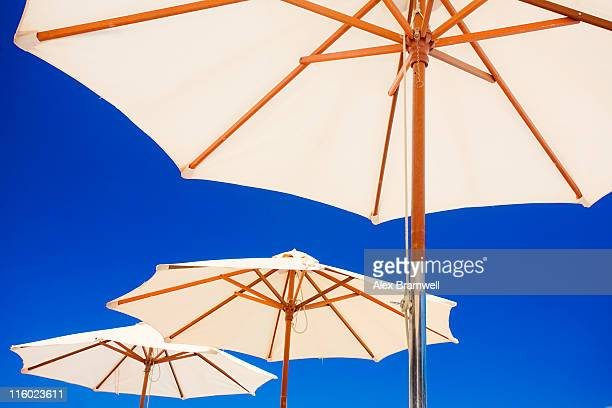white parasols - sunshade stock pictures, royalty-free photos & images