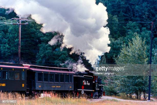 white pass & yukon route 73 steam train - a fully restored baldwin locomotive built in 1947 - leaving at full steam from the skagway-station in mid-july - 1947 stock pictures, royalty-free photos & images