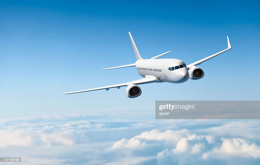 White passenger aircraft flying over clouds : Stock Photo