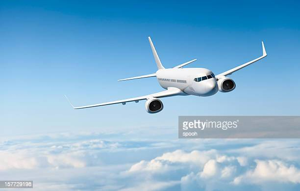 white passenger aircraft flying over clouds - aeroplane stock pictures, royalty-free photos & images