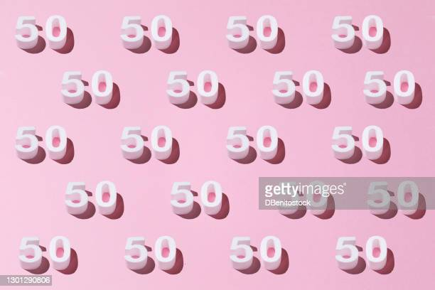 white pattern 50 on pink background. golden anniversary concept - 50th anniversary stock pictures, royalty-free photos & images