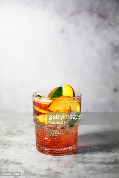white peach sangria with mint - sangria stock pictures, royalty-free photos & images