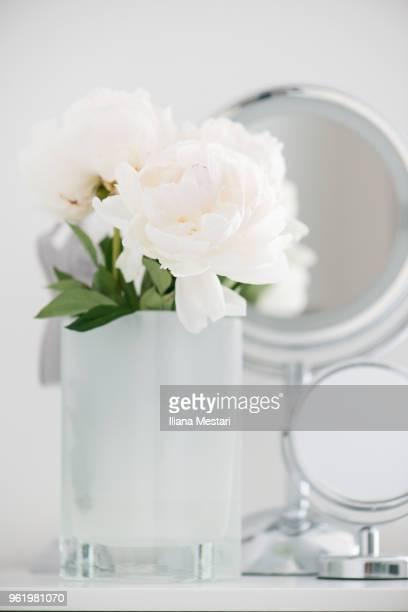 White peony in a white vase