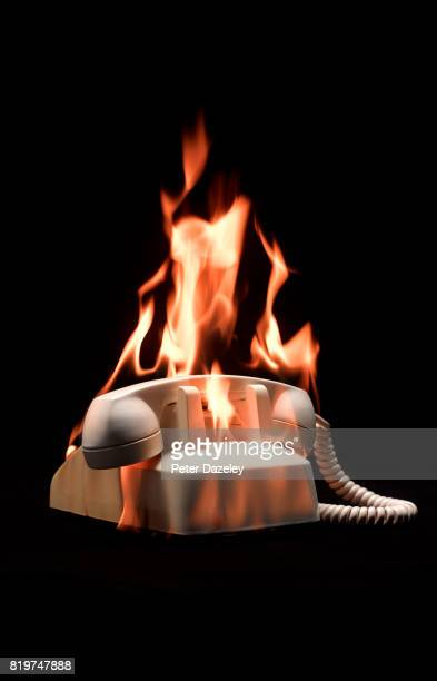 White phone on black background on fire