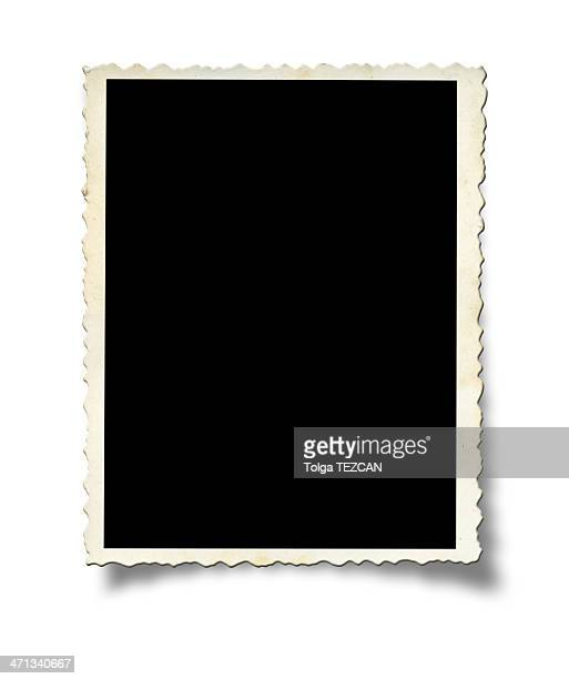 A white photo frame on a white wall