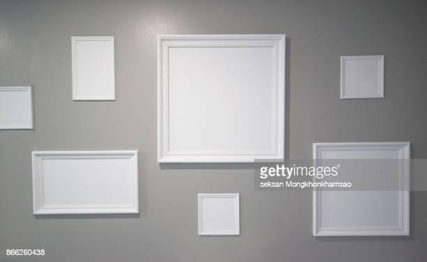white photo frame on the wall - frame stock pictures, royalty-free photos & images